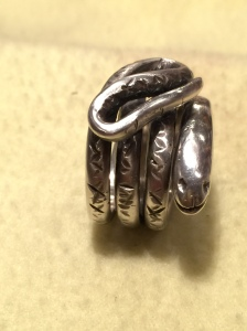 Solid silver snake ring.
