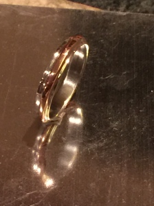 Sterling silver ring with 9ct gold band.